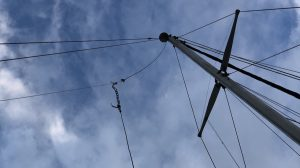 Antenna suspended from the main halyard of a Sailboat.